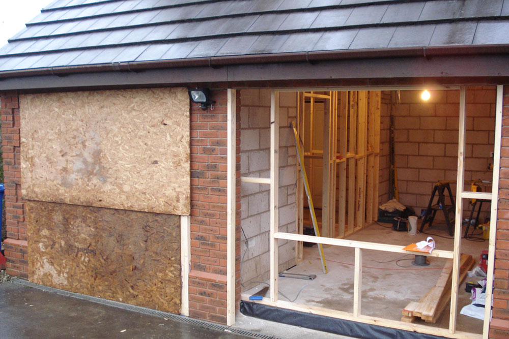 Before after garage conversion photographs more living for Convert two door garage into one